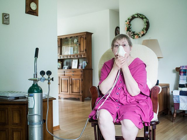 Dorene Dougherty holds a ceramic mask to help her breathe during respiratory attacks trigured by her rare medical condition, encephalopathy. She tells Public Herald that if fracking is constructed near her home it could be fatal. © jbpribanic
